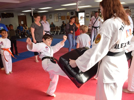 Brayden Lawrence (left) practices a kicking self defense technique ]on a pad held by by Grace Sanroma while attending a free Safety Day class held at Master Rousseau's Taekwondo Saturday, Feb. 17, 2018. In the Safety Day children were taught how to identify strangers and what to do if the strangers approach them. Self-defense techniques were also taught. Officer Micheal Jones also spoke with the children about what to do when approached by strangers and about what constituents an emergency and when to call 911.