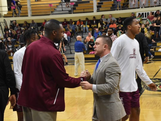 Pensacola High coach Terrence Harris, left, and Milton's Joey Murdock greet each other prior to tipoff in Saturday night's District 1-7A Boys Basketball Tournament final at Milton.
