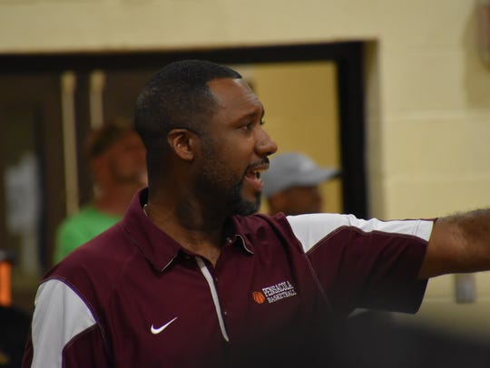 Pensacola High coach Terrence Harris yells instructions