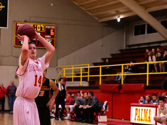 Palma sophomore Evan Pia shoots his second free throw for one of his four points in the win Tuesday night.
