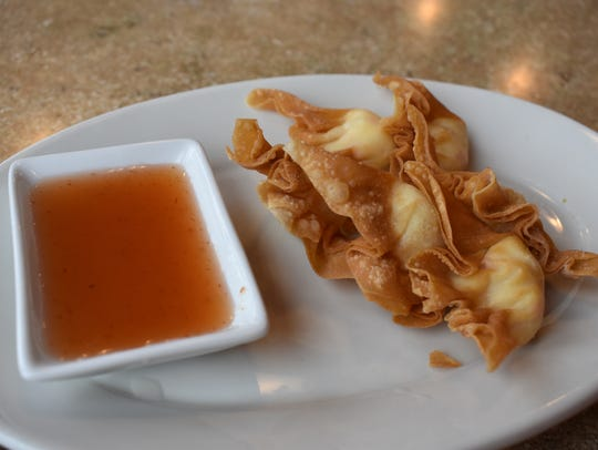 Crab delight is a fried wonton appetizer stuffed with