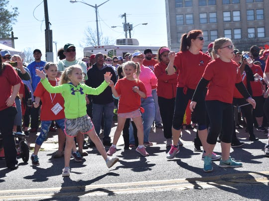 "The 12th annual Central Louisiana Heart Walk was held Saturday, March 3, 2018 in downtown Alexandria. Over 4,000 participated in the event.  ""One in every three individuals in Central Louisiana are affected by heart disease or stroke,"" said Natalie David, senior regional director of the North Louisiana American Heart Association. ""So it's really important to not only spread the message and be proactive in terms of heart health and how to prevent heart disease, but just kind of passing that message down to the families and getting the kids out and moving."""