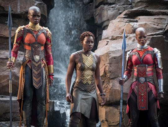 "From left, Danai Gurira, Lupita Nyong'o and Florence Kasumba in a scene from ""Black Panther."""