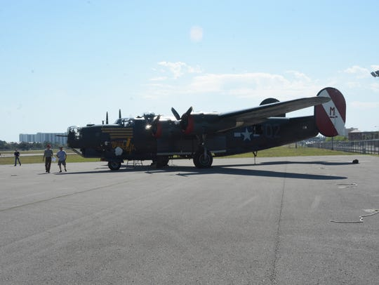 "The B-24J Liberator known as ""Witchcraft"" is in Destin, Fla., awaiting takeoff to Hattiesburg. It is the last B-24J Liberator still left flying."