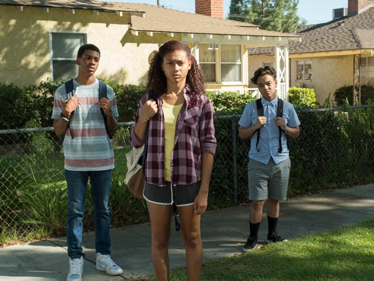 Brett Gray, left, Sierra Capri and Jason Genao play high-school freshmen in South Central Los Angeles in Netflix's 'On My Block.'