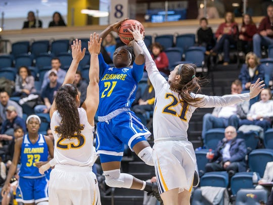 Delaware's Kiersten West goes to the basket as Drexel