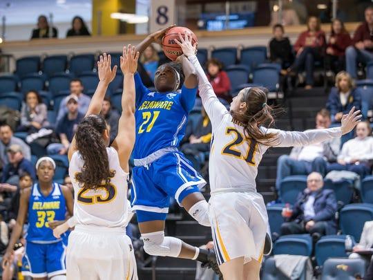 Delaware's Kiersten West goes to the basket as Drexel defends.