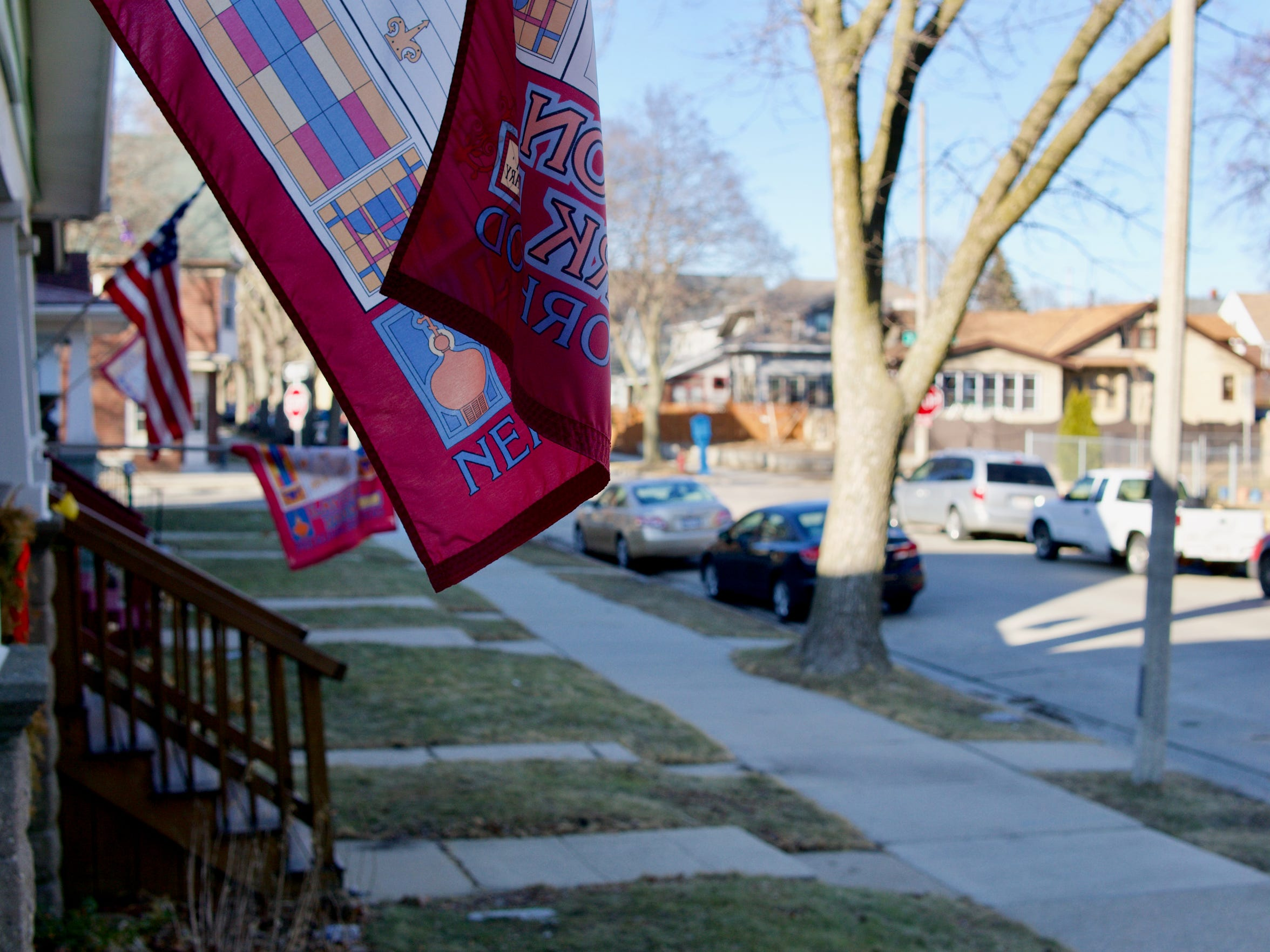Neighbors fly their colors along S. 31st St. The flags were sold to residents at a deep discount by the community development organization Layton Boulevard West Neighbors.