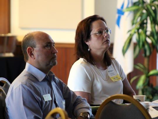 Members of Team Napolitano of Keller Williams listen
