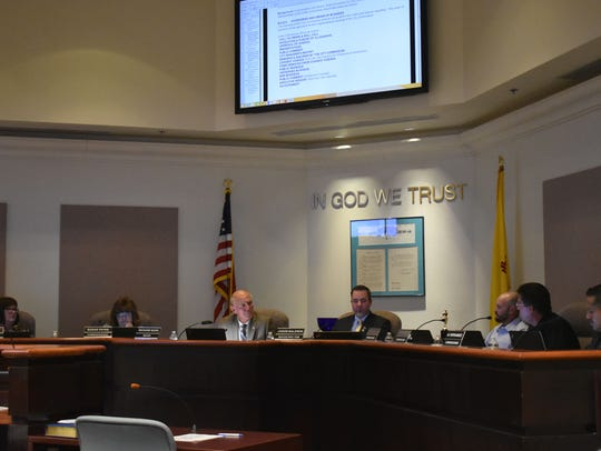 The newly reorganized City Commissioners talk during