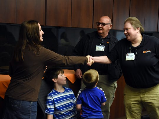 Alyssa Carter shakes hands with LifeStar employees