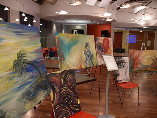 Paintings on display at a previous Art Crawl St. Cloud.