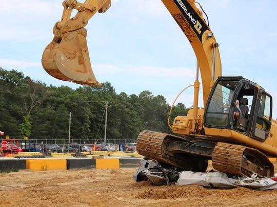Park guests operate actual JCB 8030 excavators at Diggerland USA.
