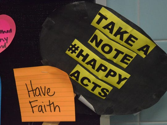 """Students at UCHS were encouraged to add to and take from the """"Take What You Need"""" board."""