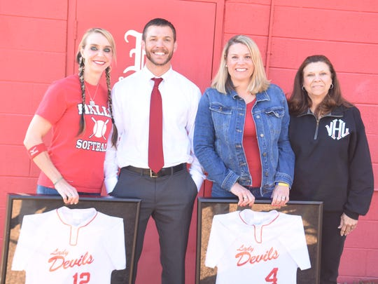 The Humphrey family – Ellisha, Cody, Stephanie and mom Vickie – gather for a photo after the Ring of Honor ceremony honoring the softball sisters on Thursday, March 22.