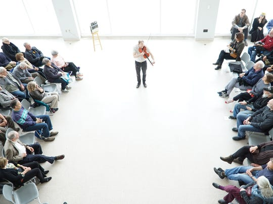 Fiddler Cleek Schrey performs for a crowd of close to 80 people at the Knoxville Museum of Art during Big Ears on Sunday, March 25.
