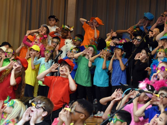 "First- and second-grade students at Bearden Elementary perform a song during the production of ""Wing It!"" on Tuesday, March 27."
