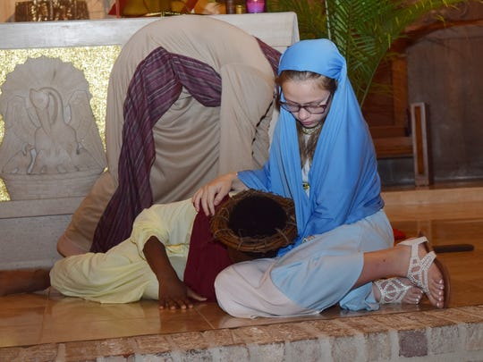 St. Frances Cabrini School sixth grader Malachi Tolbert (left) portrays Jesus Christ and Kannin Cole (right) the Virgin Mary in the performance of the Living Stations of the Cross held Thursday, March 29, 2018 at St. Frances Cabrini Church. Cabrini School sixth-graders performed the liviing Stations of the Cross which depict the 14 events leading from Jesus Christ's condemnation from Pontius Pilate to Christ's cruxcifixion. The Stations of the Cross are usually prayed during the Lenten season on Wednesdays and Fridays and on Good Friday.