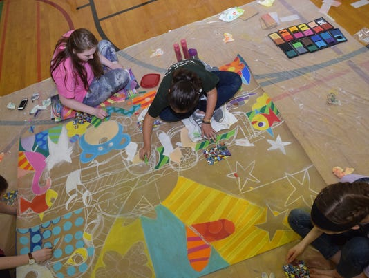 Bolton High School held their 14th annual Chalkfest Thursday, March 29, 2018. About 40-50 students recreate large versions of artwork. The event is typically held outside in front of the school but due to the rain, Chalkfest was held in the girls' gym with students will working on paper.