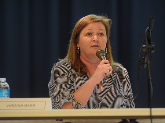 Knox County School Board District 4 representative Virginia Babb speaks at a forum while running for the school board at Fulton High School on March 29.