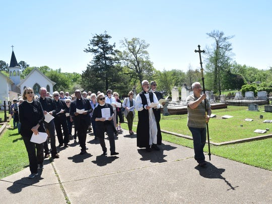"A Way of the Cross walk through Mt. Olivet Cemetery and Chapel was held in Pineville on Good Friday. The walk was organized by the Episcopal Diocese of Western Louisiana. This is the first year diocese has held the walk. ""This is an ancient service that has its roots in Jerusalem,"" said Bishop Jake Ownesby. ""That is a memorial of our Lord's Passion."" The Way of the Cross has 14 stations relating events from Jesus Christ's last day on Earth from his condemnation by Pontius Pilate to his crucifixion."