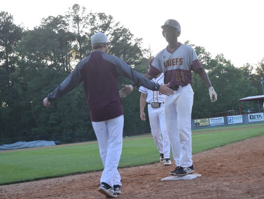Natchitoches Central outfielder AJ Walter (12) celebrates