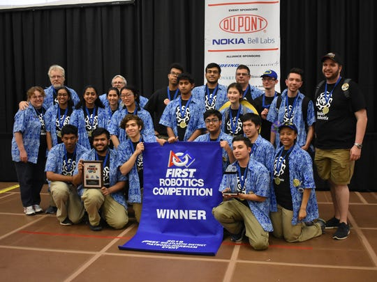 FRC team 25-Raider Robotix with their winner's blue