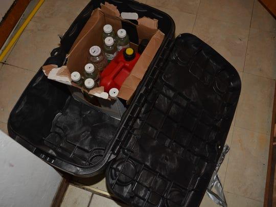Bottles of gasoline investigators say were designed to be made into Molotov cocktails.