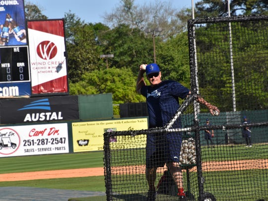 Blue Wahoos manager Jody Davis throws batting practice
