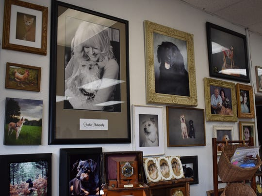 Feather Photography specializes in pet portraits, a growing interest in photography, but also offers many other photography services. In this wall of work, Jeannie Scanlon and her late dog Guido are featured in a photograph by Feather Meredith.