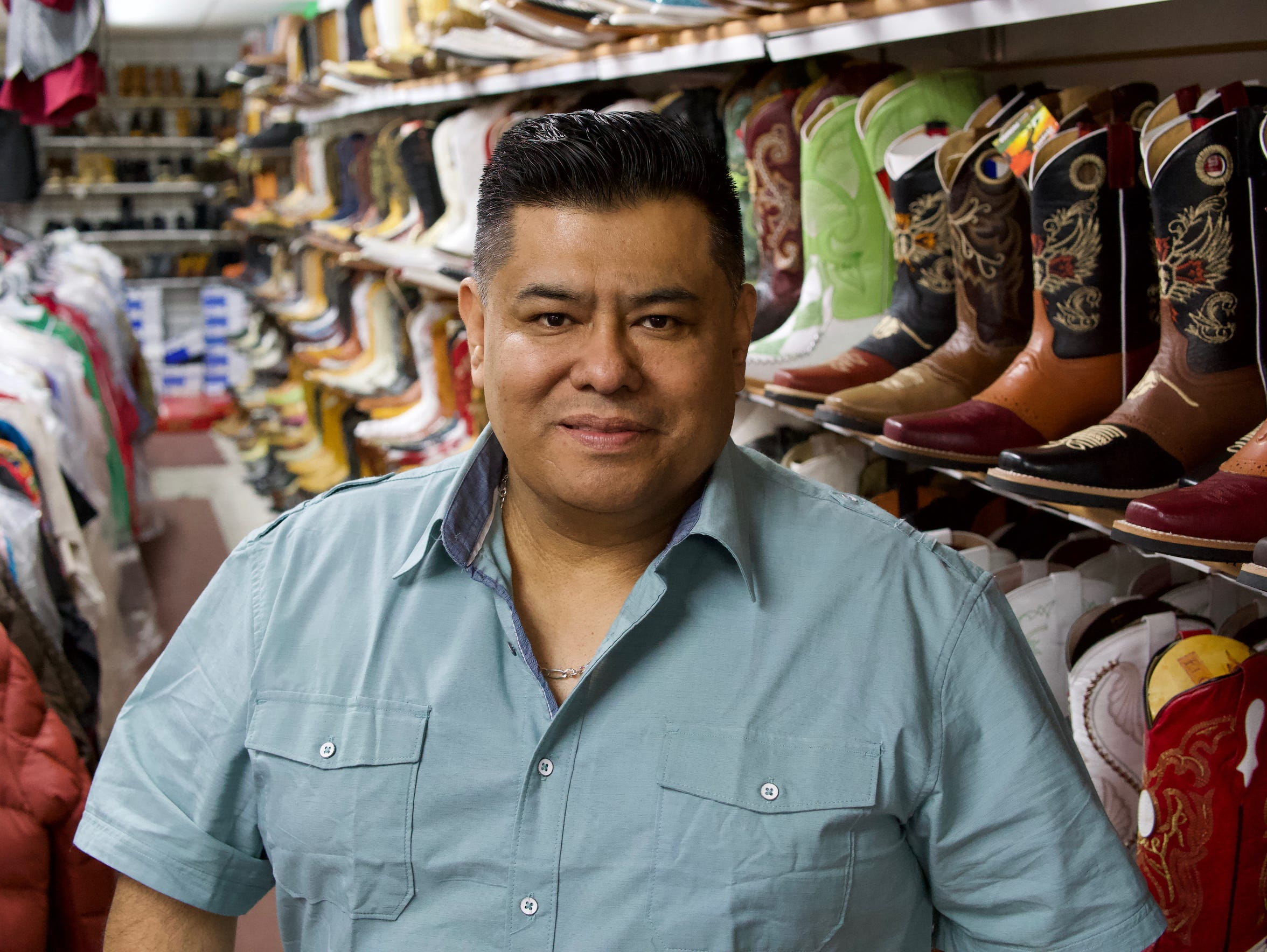 Alejandro Rivera, owner of Rivera Western Wear on South Chavez Drive in his shop: Rivera brought his family to the U.S. in 1992.