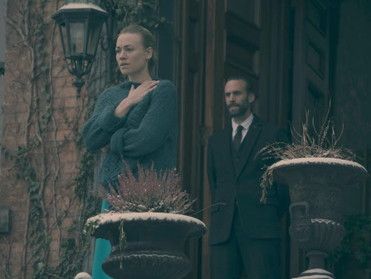 Yvonne Strahovski as Serena Joy and Joseph Fiennes