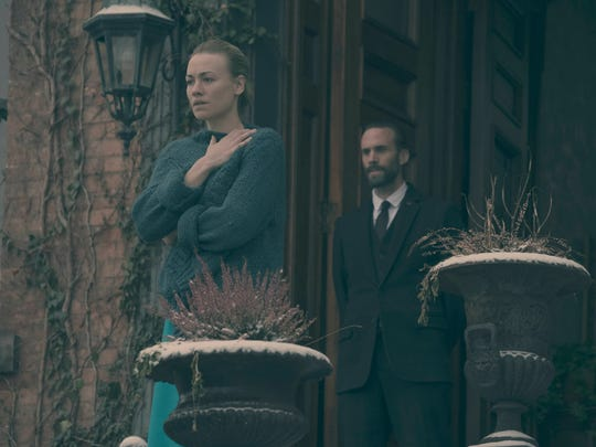 "Yvonne Strahovski as Serena Joy and Joseph Fiennes as Fred on ""The Handmaid's Tale."""