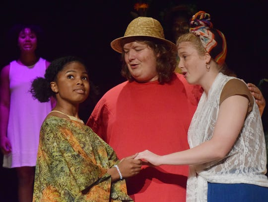 "The Alexandria Senior High School Theatre Department is set to present the Broadway musical ""Once on this Island"" at 7 p.m. Thursday (April 19, 2018) through Saturday in the auditorium at ASH. Regular tickets are $10 and student tickets are $5. ASH sophomore Seniah Wray stars as Ti Moune. Hunter Andries (center) portrays TonTon Julian and Adrian Brouillette (right) portrays Mama Euralie, who found and adopted Ti Moune as a young girl after she was spared by the gods from a devastating flood that wiped out her village. The  musical follows Ti Moune, a poor girl, who lives on one side of an island who falls in love with a wealthy boy who lives on the other side of the island. Four gods intervene in her life. The story is about racial division and unity. The island in the musical is based on Haiti."
