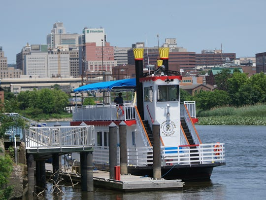 Wilmington's Riverboat Queen sits docked on the Christina River behind Iron Hill Brewery ready for customers to cruise on.
