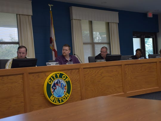 Milton Mayor Wesley Meiss (left) and members of the city council follow a discussion during a committee-of-the-whole meeting on Thursday, April 19, 2018 at city hall in Milton. Much of the more than three-hour meeting was devoted to discussion between resident Al Brewton and Meiss on a conversation between the men following an April 10 city council meeting.