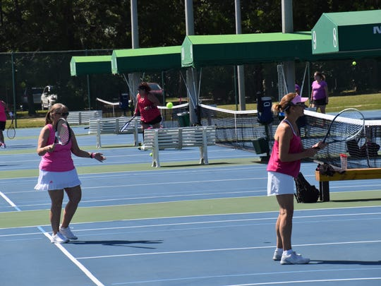 Competitors warm up Friday for first day of competition in the 16th annual Pink Ribbon Tennis Tournament.