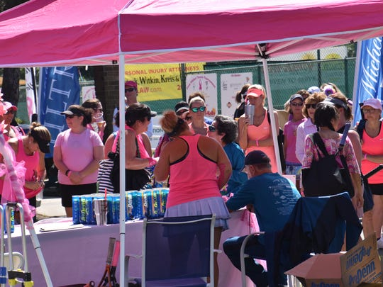 A crowd of participants await final registration and court assignments Friday in the first day of the 16th annual Pink Ribbon Tennis Tournament at Roger Scott Tennis Center.