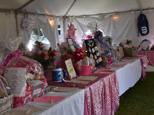 Part of the silent auction items displayed Friday at the 16th annual Pink Ribbon Tennis Tournament at Roger Scott Tennis Center.