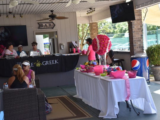 A player lounge area with food and beverages was created at Roger Scott Tennis Center for the 16th annual Pink Ribbon Tennis Tournament.