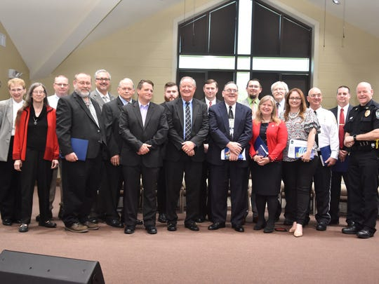 The Knoxville Police Department presented the seventeenth Chaplain Academy during graduation ceremonies at Callahan Road Baptist Church on Thursday, May 3, 2018. Pictured with the class are chaplain coordinator Pam Neal, far left in beige, and Chief of Police David Rausch, far right.