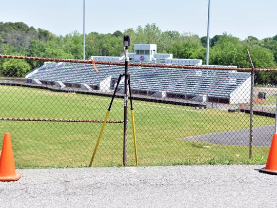 Surveying equipment sits outside the fence of the South-Doyle Middle School football field. Plans to turn the field into a BMX park are in the works.
