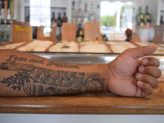 Maurice Catlett, executive chef at Matt's Fish Camp in Lewes, loves using a nakiri knife, shown here with various vegetables tatted into it.