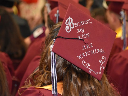 Shannon Newell's decorated mortarboard reflects her reason for working hard to obtain her Associate of Arts from New Mexico State University-Alamogordo.