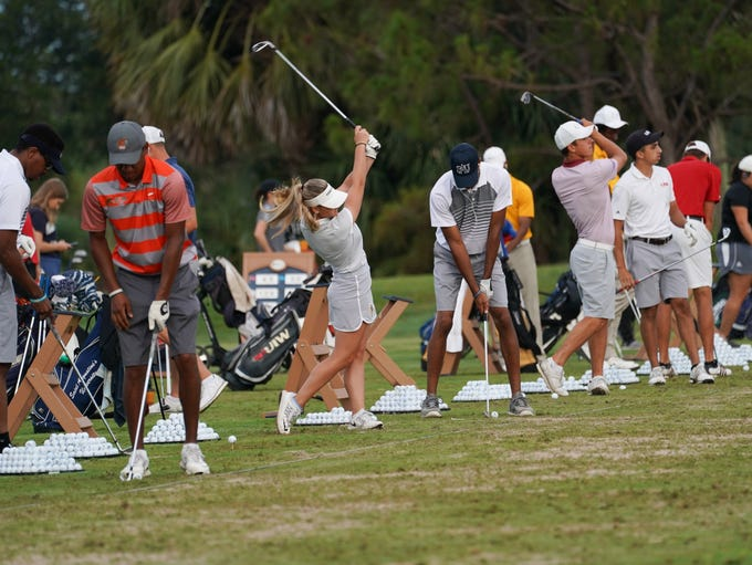Contestants on the driving range during Round Two for