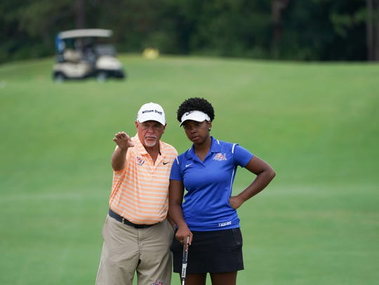 Savannah State University coach speaks with Alyssa Clements about her shot on the 18th hole of the Ryder course during Round Two for the 32nd PGA Minority Collegiate Championship at PGA Golf Club on May 12, 2018 in Port St. Lucie.