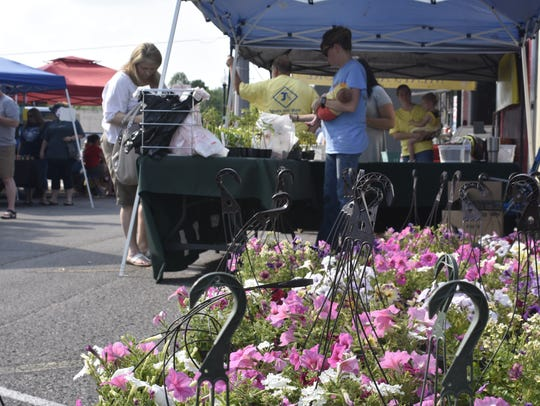 Vendors sell flowers, food, handcrafted goods and more
