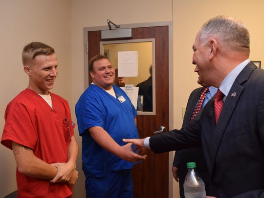 La. Gov. John Bel Edwards visits with staff at Christus Community Clinic in Alexandria last week.
