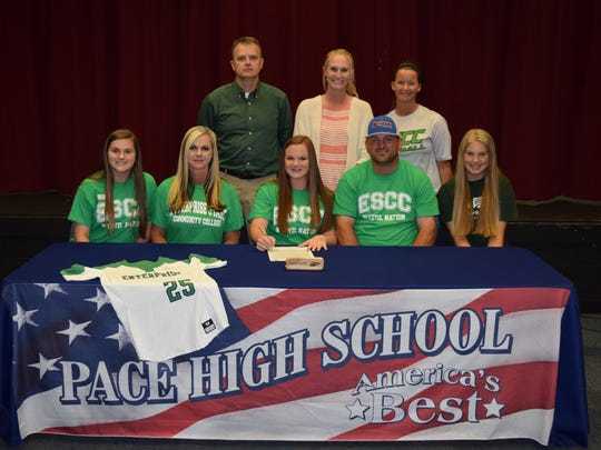 Pace High softball player Brooke Shelby recently signed to play at Enterprise (Alabama) Community College. Bottom row L-R Sister Lexie Shelby, Mother Angie Shelby, Brooke Shelby, Father Ricky Shelby, Cousin Madison Walsh Back Row L-R Principal Stephen Shell, Head Pace Coach Lauren Register,  Enterprise Coach Traci Harrison.