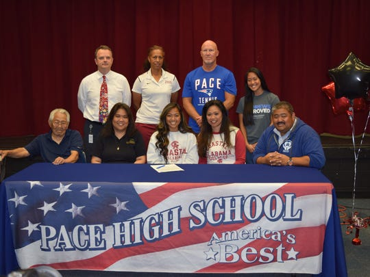 Pace HIgh tennis player Isa Lampitoc recently signed a tennis scholarship at Coastal Alabama Community College.  Front Row L-R Grandfather Arturo Luces, Aunt Rowena Nolasco, Isa Lampitoc, Mother Athena Lampitoc, Dad Mark Lampitoc Back Row –Principal Stephen Shell, Coach Ritchie, Coach Tim Dillashaw, Cousin Raeanne Nolasco.